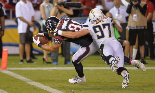 Sep 9, 2013; San Diego, CA, USA; Houston Texans tight end Owen Daniels (81) scores a touchdown against San Diego Chargers linebacker Bront Bird (97) during the second half at Qualcomm Stadium. Mandatory Credit: Robert Hanashiro-USA TODAY