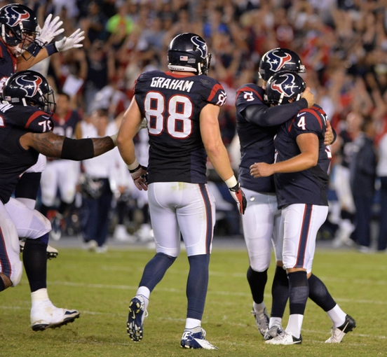 Sep 9, 2013; San Diego, CA, USA; Houston Texans kicker Randy Bullock (4) celebrates with teammates after his game-winning field goal to defeat the Chargers 31-28 at Qualcomm Stadium. Mandatory Credit: Robert Hanashiro-USA TODAY