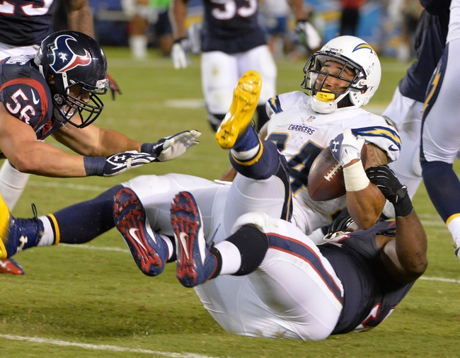 Sep 9, 2013; San Diego, CA, USA; San Diego Chargers running back Ryan Mathews (24) is brought down by Houston Texans defensive tackle Earl Mitchell (92) during fourth quarter action at Qualcomm Stadium. Mandatory Credit: Robert Hanashiro-USA TODAY
