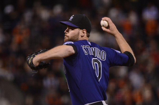 September 9, 2013; San Francisco, CA, USA; Colorado Rockies pitcher Adam Ottavino delivers a pitch against the San Francisco Giants during the 10th inning at AT&T Park. The Giants defeated the Rockies 3-2 in 10 innings. Mandatory Credit: Kyle Terada-USA TODAY Sports