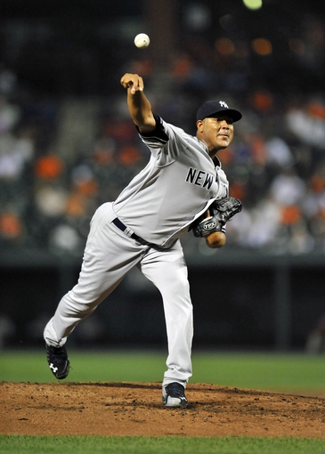 Sep 10, 2013; Baltimore, MD, USA; New York Yankees starting pitcher Ivan Nova (47) throws the ball in the third inning against the Baltimore Orioles at Oriole Park at Camden Yards. Mandatory Credit: Joy R. Absalon-USA TODAY Sports