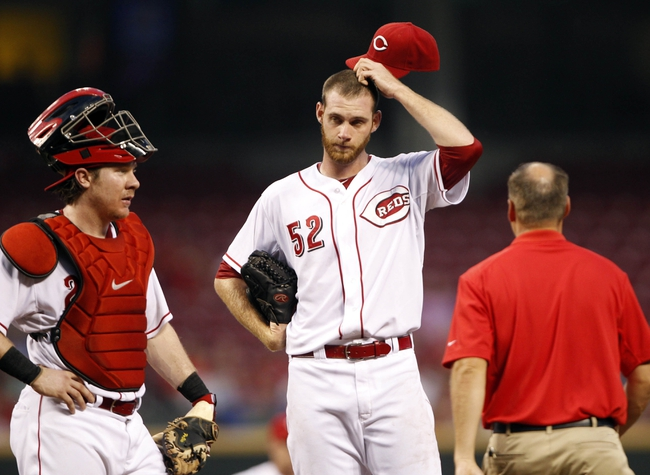 Sep 10, 2013; Cincinnati, OH, USA; Cincinnati Reds starting pitcher Tony Cingrani (52) is looked at by a team trainer during the second inning against the Chicago Cubs at Great American Ball Park. Mandatory Credit: Frank Victores-USA TODAY Sports