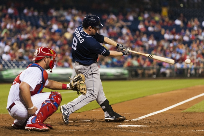 Sep 10, 2013; Philadelphia, PA, USA; San Diego Padres second baseman Jedd Gyorko (9) singles during the fourth inning against the Philadelphia Phillies at Citizens Bank Park. Mandatory Credit: Howard Smith-USA TODAY Sports