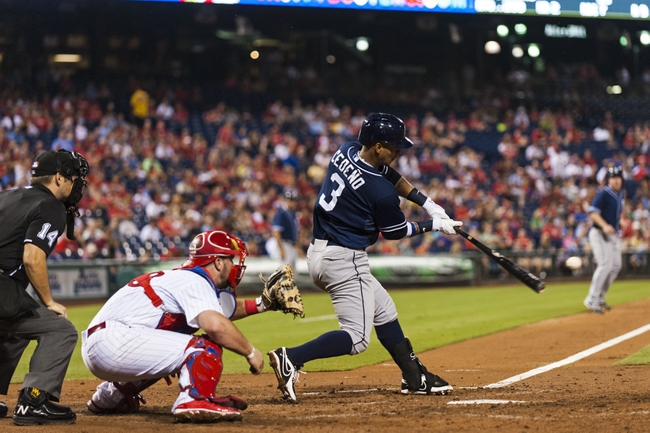Sep 10, 2013; Philadelphia, PA, USA; San Diego Padres shortstop Ronny Cedeno (3) hits an RBI double during the fourth inning against the Philadelphia Phillies at Citizens Bank Park. Mandatory Credit: Howard Smith-USA TODAY Sports