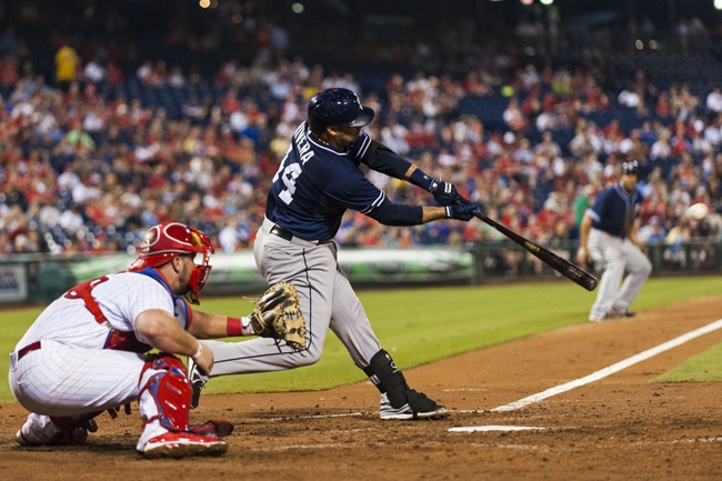 Sep 10, 2013; Philadelphia, PA, USA; San Diego Padres catcher Rene Rivera (44) hits a two RBI double during the fourth inning against the Philadelphia Phillies at Citizens Bank Park. Mandatory Credit: Howard Smith-USA TODAY Sports