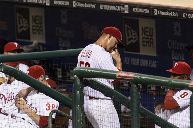 Sep 10, 2013; Philadelphia, PA, USA; Philadelphia Phillies pitcher Tyler Cloyd (50) heads to the bench after being relieved during the fifth inning against the San Diego Padres at Citizens Bank Park. Mandatory Credit: Howard Smith-USA TODAY Sports