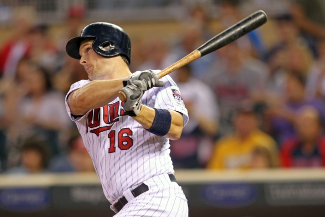Sep 10, 2013; Minneapolis, MN, USA; Minnesota Twins outfielder Josh Willingham (16) hits a home run during the second inning against the Oakland Athletics at Target Field. Mandatory Credit: Brace Hemmelgarn-USA TODAY Sports