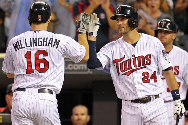 Sep 10, 2013; Minneapolis, MN, USA; Minnesota Twins outfielder Josh Willingham (16) is congratulated by third baseman Trevor Plouffe (24) after hitting a home run during the second inning against the Oakland Athletics at Target Field. Mandatory Credit: Brace Hemmelgarn-USA TODAY Sports