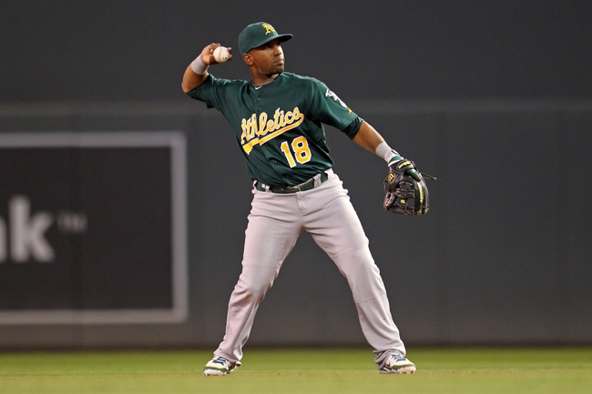 Sep 10, 2013; Minneapolis, MN, USA; Oakland Athletics second baseman Alberto Callaspo (18) throws the ball during the second inning against the Minnesota Twins at Target Field. Mandatory Credit: Brace Hemmelgarn-USA TODAY Sports