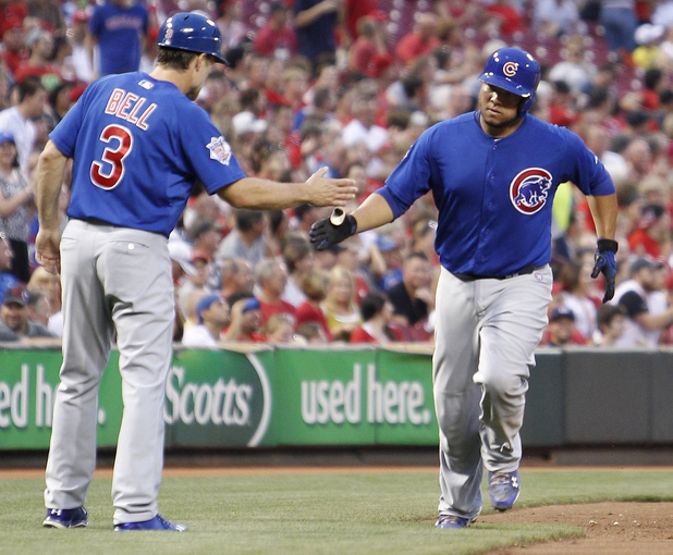 Sep 10, 2013; Cincinnati, OH, USA; Chicago Cubs catcher Welington Castillo (53) is congratulated by third base coach David Bell (3) after hitting a home run during the second inning against the Cincinnati Reds at Great American Ball Park. Mandatory Credit: Frank Victores-USA TODAY Sports
