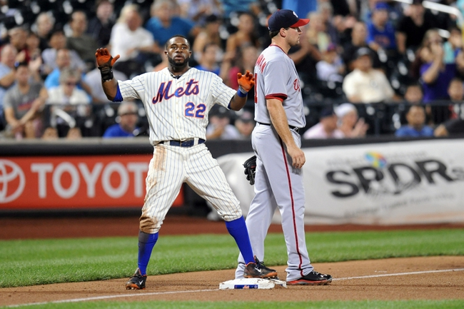 Sep 10, 2013; New York, NY, USA; New York Mets left fielder Eric Young Jr. (22) reacts after going from first base to third base after a wild pitch and error during the fifth inning against the Washington Nationals after at Citi Field. Mandatory Credit: Joe Camporeale-USA TODAY Sports
