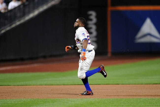Sep 10, 2013; New York, NY, USA; New York Mets left fielder Eric Young Jr. (22) goes from first base to third base after a wild pitch and error during the fifth inning against the Washington Nationals after at Citi Field. Mandatory Credit: Joe Camporeale-USA TODAY Sports
