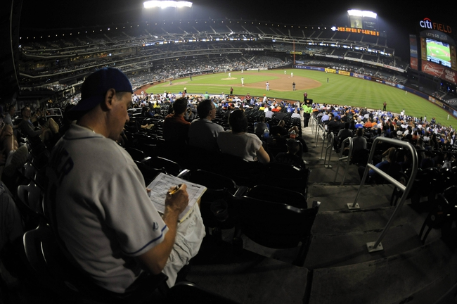 Sep 10, 2013; New York, NY, USA; New York Mets fan Gary Berger keeps score during the game against the Washington Nationals during the eighth inning at Citi Field. Mandatory Credit: Joe Camporeale-USA TODAY Sports