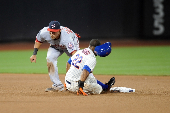 Sep 10, 2013; New York, NY, USA; Washington Nationals shortstop Ian Desmond (20) tags out New York Mets left fielder Eric Young Jr. (22) on a steal attempt during the seventh inning at Citi Field. Mandatory Credit: Joe Camporeale-USA TODAY Sports