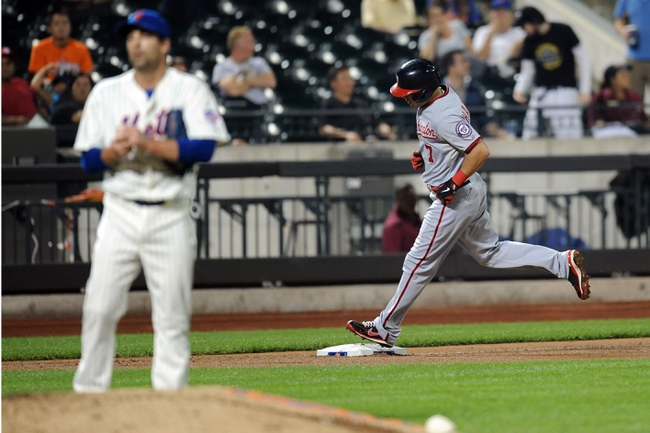 Sep 10, 2013; New York, NY, USA; Washington Nationals left fielder Scott Hairston (7) rounds third base after hitting a home run in the ninth inning against New York Mets relief pitcher Tim Byrdak (40) at Citi Field. Mandatory Credit: Joe Camporeale-USA TODAY Sports