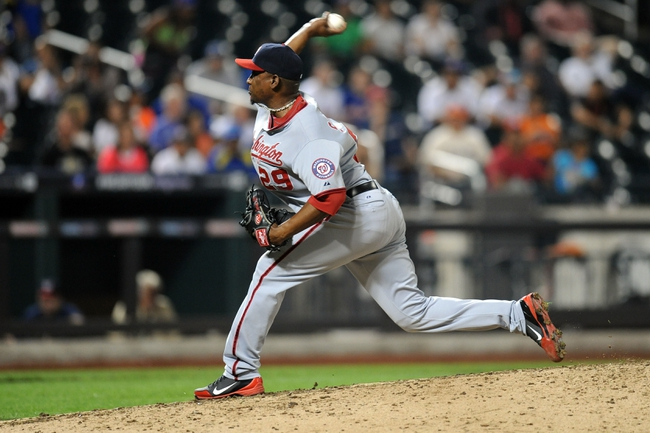 Sep 10, 2013; New York, NY, USA; Washington Nationals relief pitcher Rafael Soriano (29) throws a pitch during the ninth inning against the New York Mets at Citi Field. The Nationals won the game 6-3. Mandatory Credit: Joe Camporeale-USA TODAY Sports