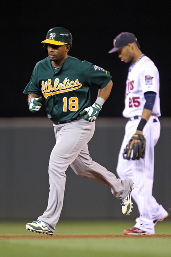 Sep 10, 2013; Minneapolis, MN, USA; Oakland Athletics second baseman Alberto Callaspo (18) rounds the bases after hitting a home run during the fifth inning against the Minnesota Twins at Target Field. Mandatory Credit: Brace Hemmelgarn-USA TODAY Sports