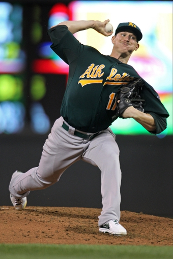 Sep 10, 2013; Minneapolis, MN, USA; Oakland Athletics pitcher Jarrod Parker (11) delivers a pitch during the fourth inning against the Minnesota Twins at Target Field. Mandatory Credit: Brace Hemmelgarn-USA TODAY Sports