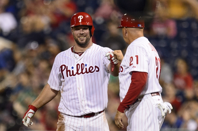 Sep 10, 2013; Philadelphia, PA, USA; Philadelphia Phillies catcher Cameron Rupp (29) celebrates with first base coach Wally Joyner after getting his first hit during the eighth inning against the San Diego Padres at Citizens Bank Park. The Padres defeated the Phillies 8-2. Mandatory Credit: Howard Smith-USA TODAY Sports