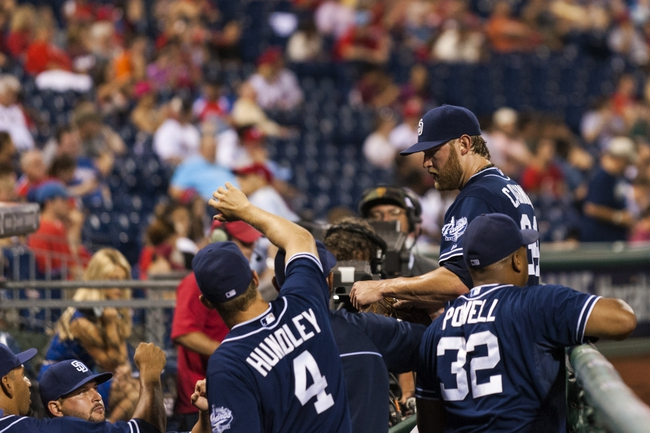 Sep 10, 2013; Philadelphia, PA, USA; San Diego Padres pitcher Andrew Cashner (34) is welcomed in the dugout after being relieved during the eighth inning against the Philadelphia Phillies at Citizens Bank Park. The Padres defeated the Phillies 8-2. Mandatory Credit: Howard Smith-USA TODAY Sports