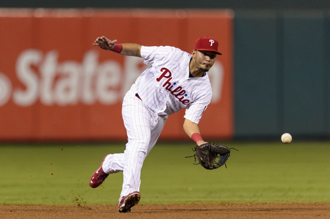 Sep 10, 2013; Philadelphia, PA, USA; Philadelphia Phillies left fielder Freddy Galvis (13) fields a ground ball during the ninth inning against the San Diego Padres at Citizens Bank Park. The Padres defeated the Phillies 8-2. Mandatory Credit: Howard Smith-USA TODAY Sports