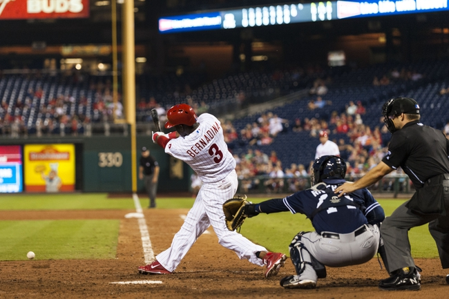 Sep 10, 2013; Philadelphia, PA, USA; Philadelphia Phillies center fielder Roger Bernadina (3) singles during the eighth inning against the San Diego Padres at Citizens Bank Park. The Padres defeated the Phillies 8-2. Mandatory Credit: Howard Smith-USA TODAY Sports