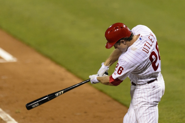 Sep 10, 2013; Philadelphia, PA, USA; Philadelphia Phillies second baseman Chase Utley (26) doubles during the fourth inning against the San Diego Padres at Citizens Bank Park. The Padres defeated the Phillies 8-2. Mandatory Credit: Howard Smith-USA TODAY Sports
