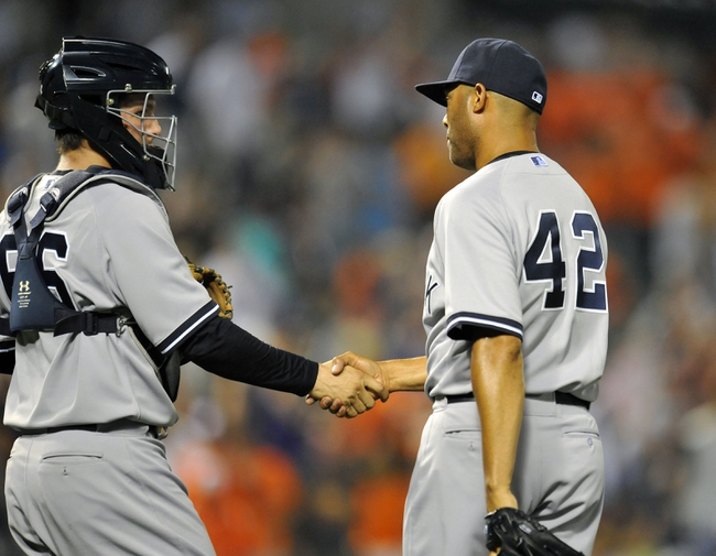 Sep 10, 2013; Baltimore, MD, USA; New York Yankees catcher JR Murphy (66) congratulates pitcher Mariano Rivera (42) after a game against the Baltimore Orioles at Oriole Park at Camden Yards. The Yankees defeated the Orioles 7-5. Mandatory Credit: Joy R. Absalon-USA TODAY Sports