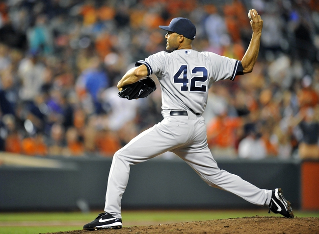 Sep 10, 2013; Baltimore, MD, USA; New York Yankees pitcher Mariano Rivera (42) throws in the eighth inning against the Baltimore Orioles at Oriole Park at Camden Yards. The Yankees defeated the Orioles 7-5. Mandatory Credit: Joy R. Absalon-USA TODAY Sports