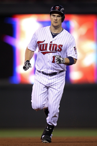 Sep 10, 2013; Minneapolis, MN, USA; Minnesota Twins outfielder Josh Willingham (16) rounds the bases after hitting a home run during the eighth inning against the Oakland Athletics at Target Field. The Twins won 4-3. Mandatory Credit: Brace Hemmelgarn-USA TODAY Sports