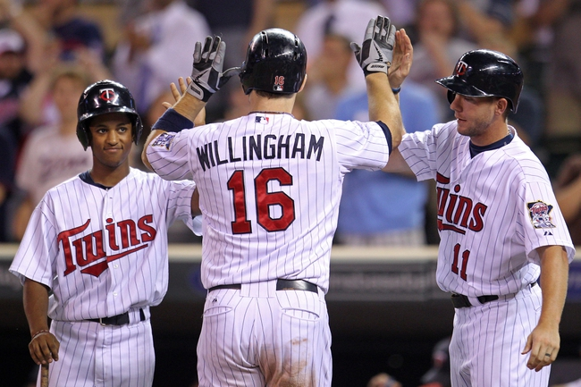 Sep 10, 2013; Minneapolis, MN, USA; Minnesota Twins outfielder Josh Willingham (16) is congratulated by outfielder Clete Thomas (11) after hitting a home run during the eighth inning against the Oakland Athletics at Target Field. The Twins won 4-3. Mandatory Credit: Brace Hemmelgarn-USA TODAY Sports
