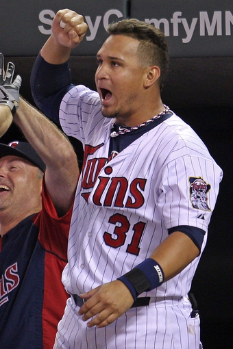 Sep 10, 2013; Minneapolis, MN, USA; Minnesota Twins outfielder Oswaldo Arcia (31) celebrates a home run hit by outfielder Josh Willingham (not pictured) during the eighth inning against the Oakland Athletics at Target Field. The Twins won 4-3. Mandatory Credit: Brace Hemmelgarn-USA TODAY Sports
