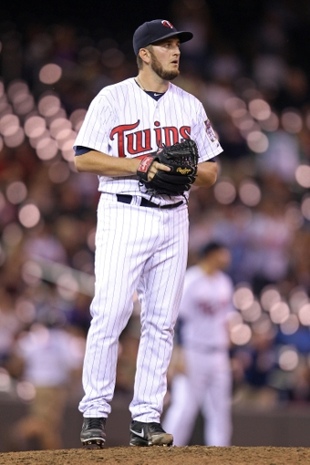 Sep 10, 2013; Minneapolis, MN, USA; Minnesota Twins pitcher Glen Perkins (15) looks on during the ninth inning against the Oakland Athletics at Target Field. The Twins won 4-3. Mandatory Credit: Brace Hemmelgarn-USA TODAY Sports