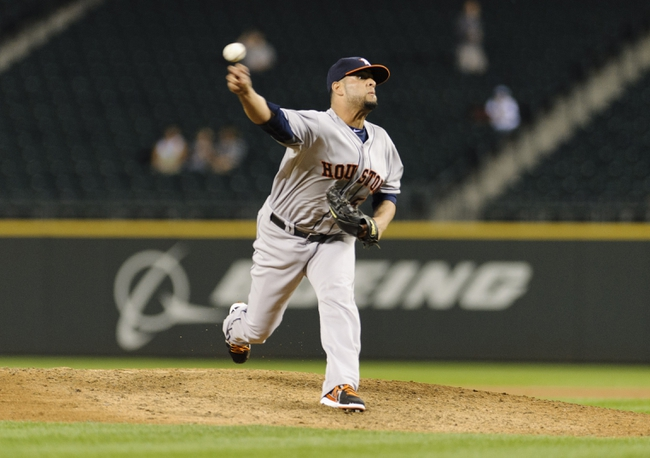 Sep 10, 2013; Seattle, WA, USA; Houston Astros relief pitcher Rhiner Cruz (55) pitches to the Seattle Mariners during the 8th inning at Safeco Field. Mandatory Credit: Steven Bisig-USA TODAY Sports