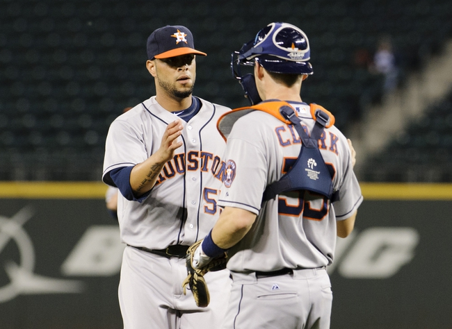 Sep 10, 2013; Seattle, WA, USA; Houston Astros relief pitcher Rhiner Cruz (55) high fives Houston Astros catcher Cody Clark (39) after defeating the Seattle Mariners at Safeco Field. Houston defeated Seattle 13-2. Mandatory Credit: Steven Bisig-USA TODAY Sports