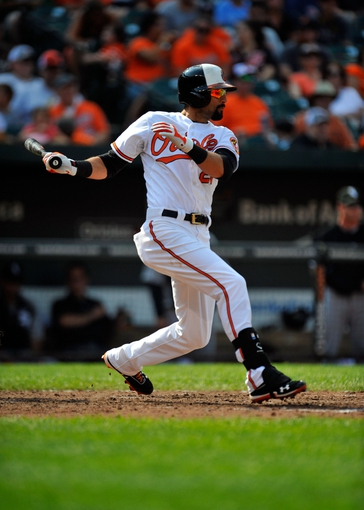 Sep 8, 2013; Baltimore, MD, USA; Baltimore Orioles right fielder Nick Markakis (21) bats in the seventh inning against the Chicago White Sox at Oriole Park at Camden Yards. The White Sox defeated the Orioles 4-2. Mandatory Credit: Joy R. Absalon-USA TODAY Sports