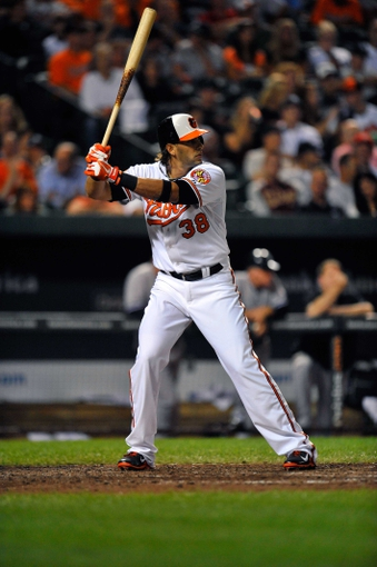 Sep 9, 2013; Baltimore, MD, USA; Baltimore Orioles left fielder Michael Morse (38) bats in the sixth inning against the New York Yankees at Oriole Park at Camden Yards. The Orioles defeated the Yankees 4-2. Mandatory Credit: Joy R. Absalon-USA TODAY Sports