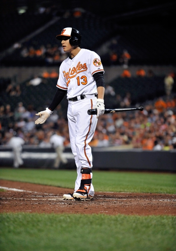 Sep 9, 2013; Baltimore, MD, USA; Baltimore Orioles third baseman Manny Machado (13) argues a called third strike in the third inning against the New York Yankees at Oriole Park at Camden Yards. The Orioles defeated the Yankees 4-2. Mandatory Credit: Joy R. Absalon-USA TODAY Sports