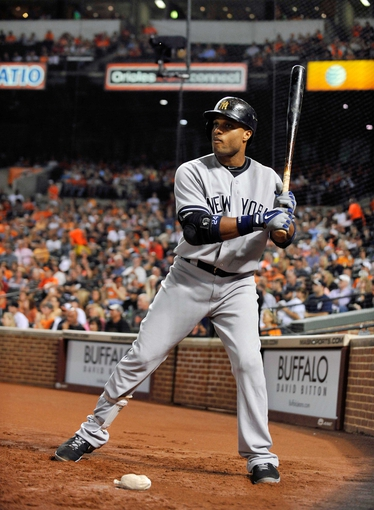 Sep 9, 2013; Baltimore, MD, USA; New York Yankees second baseman Robinson Cano (24) in the on-deck circle during the third inning against the Baltimore Orioles at Oriole Park at Camden Yards. The Orioles defeated the Yankees 4-2. Mandatory Credit: Joy R. Absalon-USA TODAY Sports