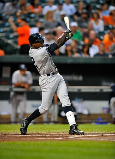 Sep 9, 2013; Baltimore, MD, USA; New York Yankees left fielder Alfonso Soriano (12) bats in the first inning against the Baltimore Orioles at Oriole Park at Camden Yards. The Orioles defeated the Yankees 4-2. Mandatory Credit: Joy R. Absalon-USA TODAY Sports