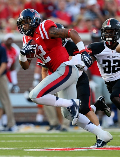 Sep 7, 2013; Oxford, MS, USA; Mississippi Rebels wide receiver Donte Moncrief (12) advances the ball during the game against the Southeast Missouri State Redhawks at Vaught-Hemingway Stadium. Mississippi Rebels defeated the Southeast Missouri State Redhawks 31-13.  Mandatory Credit: Spruce Derden-USA TODAY Sports