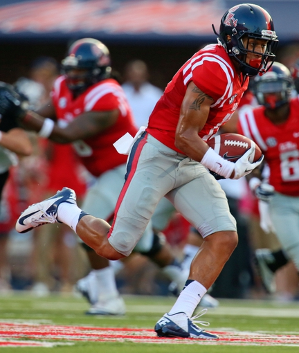 Sep 7, 2013; Oxford, MS, USA; Mississippi Rebels tight end Evan Engram (17) advances the ball during the game against the Southeast Missouri State Redhawks at Vaught-Hemingway Stadium. Mississippi Rebels defeated the Southeast Missouri State Redhawks 31-13.  Mandatory Credit: Spruce Derden-USA TODAY Sports