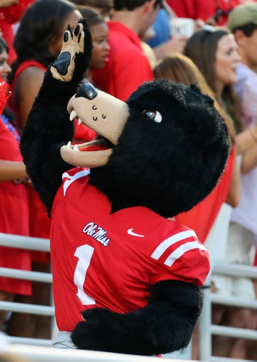 Sep 7, 2013; Oxford, MS, USA; Mississippi Rebels mascot Rebel celebrates with fans during the game against the Southeast Missouri State Redhawks at Vaught-Hemingway Stadium. Mississippi Rebels defeated the Southeast Missouri State Redhawks 31-13.  Mandatory Credit: Spruce Derden-USA TODAY Sports