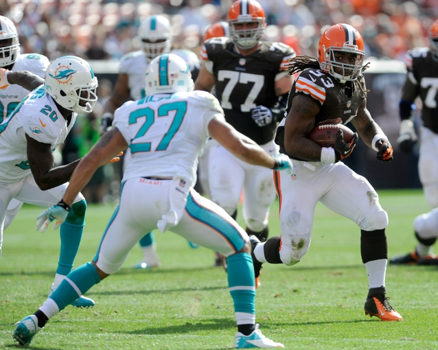 Sep 8, 2013; Cleveland, OH, USA; Cleveland Browns running back Trent Richardson (33) runs against Miami Dolphins safety Jimmy Wilson (27) at FirstEnergy Stadium. Mandatory Credit: Ken Blaze-USA TODAY Sports