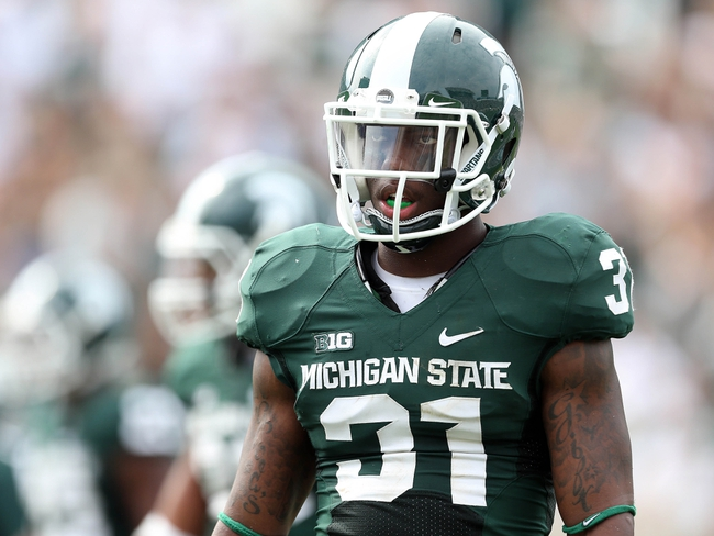 Sep 7, 2013; East Lansing, MI, USA; Michigan State Spartans cornerback Darqueze Dennard (31) walks off the field during the 2nd half of a game between the Michigan State Spartans and the South Florida Bulls  at Spartan Stadium. MSU won 21-6. Mandatory Credit: Mike Carter-USA TODAY Sports