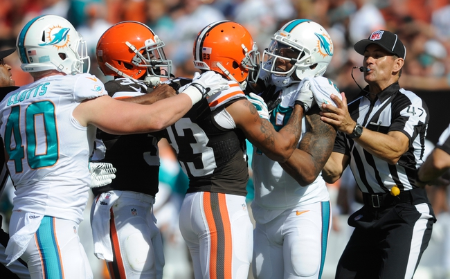 Sep 8, 2013; Cleveland, OH, USA; Cleveland Browns cornerback Joe Haden (23) scuffles with a Miami Dolphins player at FirstEnergy Stadium. Mandatory Credit: Ken Blaze-USA TODAY Sports