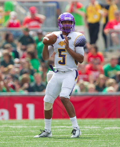 Sep 7, 2013; Madison, WI, USA; Tennessee Tech Golden Eagles quarterback Darian Stone (5) during the game against the Wisconsin Badgers at Camp Randall Stadium.  Wisconsin won 48-0.  Mandatory Credit: Jeff Hanisch-USA TODAY Sports