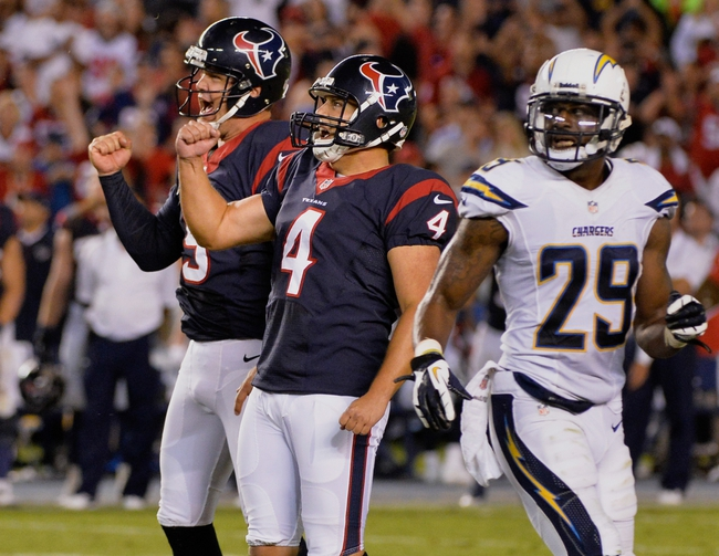 Sep 9, 2013; San Diego, CA, USA; Houston Texans kicker Randy Bullock (4) and holder punter Shane Lechler (9) celebrate Bullock's game-winning field goal as San Diego Chargers defensive back Shareece Wright (29) looks on at Qualcomm Stadium. The Texans scored a come-from-behind win 31-28.Mandatory Credit: Robert Hanashiro-USA TODAY