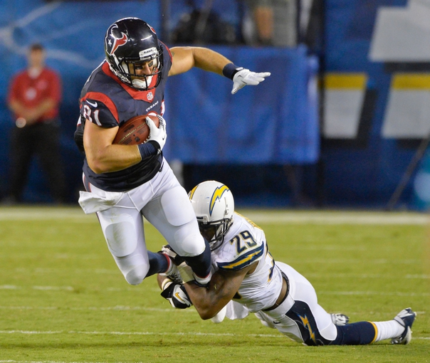 Sep 9, 2013; San Diego, CA, USA; Houston Texans tight end Owen Daniels (81) is tackled by San Diego Chargers defensive back Shareece Wright (29) during fourth quarter action at Qualcomm Stadium. Mandatory Credit: Robert Hanashiro-USA TODAY