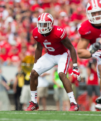 Sep 7, 2013; Madison, WI, USA; Wisconsin Badgers cornerback Darius Hillary (5) during the game against the Tennessee Tech Golden Eagles at Camp Randall Stadium.  Wisconsin won 48-0.  Mandatory Credit: Jeff Hanisch-USA TODAY Sports